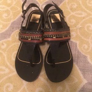 Black sandals with brown and gold detail